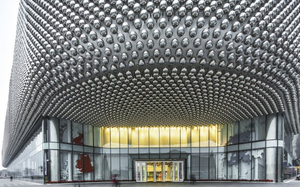 The architectural design of the façade incorporates stainless steel spheres
