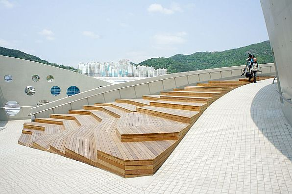 A ramp descends from the garden areas of the roof